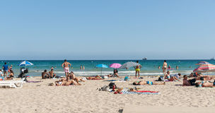 Beach-goers enjoyng hot summer day at Postiguet Beach, Alicante Stock Photos