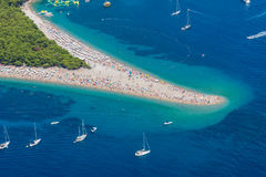 Beach Golden Horn, Zlatni rat plaža 2. Beach Golden horn taken from helicopter, in August 2015. Cristal blue water and pebble beach Royalty Free Stock Image
