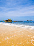 Beach of golden sand. In the Spanish Atlantic Ocean royalty free stock photography