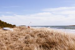 Beach in Gotland close to Klintehamn. Coastline with boat at the beach in Gotland nearby Klintehamn Stock Photography
