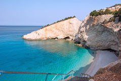 Beach in Greece. Beautiful beach scene with limestone cliff face in Lefkada, Greece Stock Photo