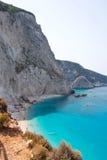 Beach in Greece. Beautiful beach scene with limestone cliff face in Lefkada, Greece Stock Photos