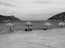 Beach in Greece. A black and white picture of a Greek beach at the bottom of the mountains Royalty Free Stock Photo