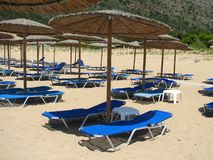 Sun loungers and parasols. Beach on the Greek Peninsula Peloponnese with amenities stock image