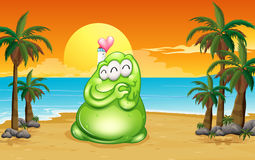 A beach with a green monster Stock Photography