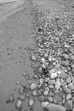 Beach of grey pebbles and rocks Stock Photo