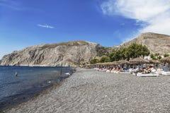 Beach with grey volcanic sand at Kamari, Santorini island Royalty Free Stock Photo