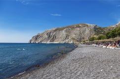 Beach with grey volcanic sand at Kamari, Santorini island Royalty Free Stock Image