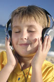 Beach Groove. Leisurely listening to music at the beach Royalty Free Stock Image