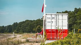 Beach guard and Baltic sea royalty free stock image