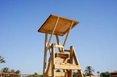 Beach guard chair. High wooden guard chair on the beach stock photos