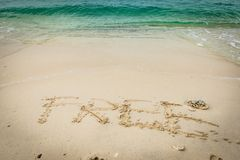 Beach on gulf of Thailand with word Free written on the sand Stock Images