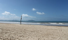 Beach on Hainan island. Scenic view of sandy beach on Hainan island with blue sky and cloudscape background, China Royalty Free Stock Photography