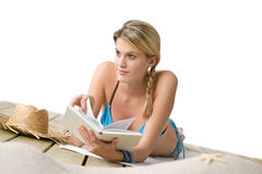 Beach - Happy woman relax in bikini with book Stock Photo