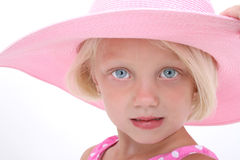 Beach Hat. Beautiful young girl with blonde hair in large pink beach hat Royalty Free Stock Images