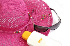 Beach hat, bottle of balm solar. Stock Photo