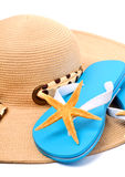 Beach hat, flip flops and starfish Royalty Free Stock Photos