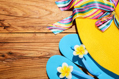 Beach hat and flip-flops Stock Image