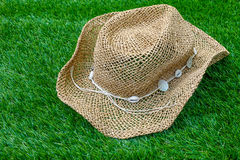 Beach hat on green grass Royalty Free Stock Image