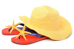 Beach hat, red flip flops with starfishes Stock Images