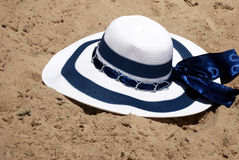 The beach hat in sand Royalty Free Stock Photography