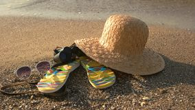Beach hat on sand. Black vintage binoculars. New horizons await you stock video