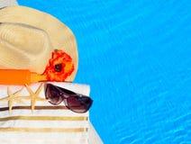 Beach hat, sunglasses, bath towel, sun spray, starfish near Royalty Free Stock Images