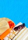 Beach hat, sunglasses, bath towel, sun spray, starfish near Royalty Free Stock Photo