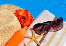 Beach hat, sunglasses, bath towel. Stock Images