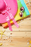 Beach hat, sunglasses,beach towel Royalty Free Stock Photography