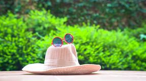 Beach hat with sunglasses. With green nature background. Summer holiday or vacation concept stock photo