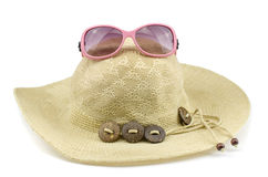 Beach hat with sunglasses Royalty Free Stock Image