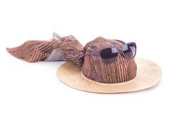 Beach hat and sunglasses Stock Image