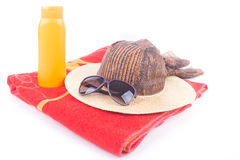 Beach hat and sunglasses on towel Royalty Free Stock Photos
