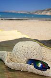 Beach hat sunglasses umbrella reflection Stock Photo