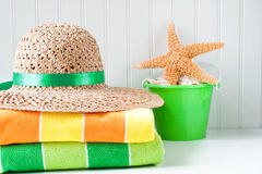 Beach hat and towels Stock Photography