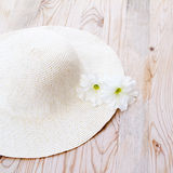 Beach hat with white flower Stock Photos