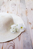 Beach hat with white flower Royalty Free Stock Photo