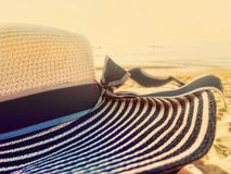 Beach hat wide large brim on a beach at sunset Royalty Free Stock Images