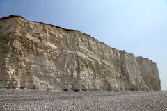Beach head chalk cliffs and pebble beach against blue sky Royalty Free Stock Image