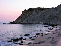 Beach and headland at dusk in the Algarve, Portugal Stock Photography