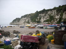 Beach with headland, fishing boats and pots Stock Image