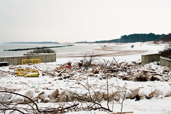 Beach after heavy storm in Poland. Darlowo Poland - the beach after a heavy storm in winter 2016, the area cluttered with branches, dustbins, litter. Anti flood Royalty Free Stock Photos