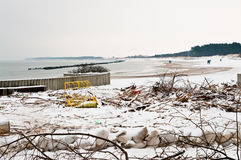 Beach after heavy storm in Poland. Darlowo Poland - the beach after a heavy storm in winter 2016, the area cluttered with branches, dustbins, litter. Anti flood Royalty Free Stock Photo