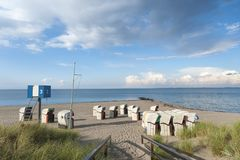 Beach in Heiligenhafen. Beach with canopied wicker beach chairs in Heiligenhafen at the Baltic Sea Royalty Free Stock Photography