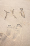 Beach. 'HI' written on a beach, golden sand outdoors background. Outside artistic sign Stock Photos