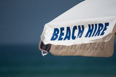 Beach hire umbrella sign Royalty Free Stock Image