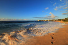 Beach Holiday. Lonely footprints in the sand of a beautiful Hawaiian Island Royalty Free Stock Image