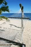 Beach holiday. Island beach scene with hammock stock photos