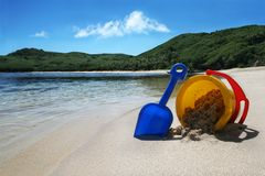 Beach holiday. Summer holiday concept with childs bucket and spade stock images
